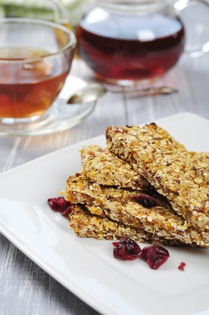 Muesli Bars on plate with nuts and dried fruits Stock Photo - 19427630