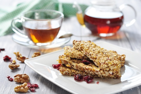 Muesli Bars on plate with nuts and dried fruits photo
