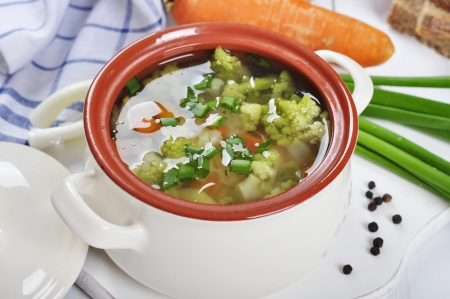 Vegetable soup with broccoli, cauliflower, pea and carrot photo