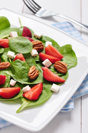spinach salad: Spinach salad with strawberries, goats cheese and pecan nut Stock Photo