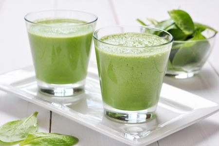 fresh spinach: Spinach smoothies in glass on a wooden background Stock Photo