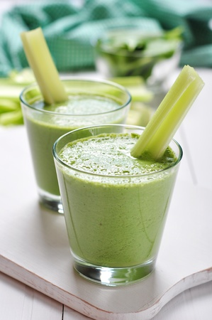 celery: Green vegetable smoothie with celery and spinach on wooden background Stock Photo