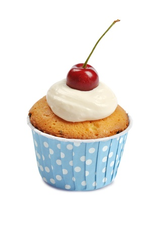 Cupcake with whipped cream and cherry isolated on white background photo