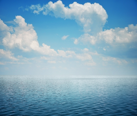 liquid summer: Blue sea with waves and sky with airy clouds