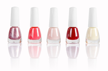 bright nail polishes isolated on white. Clipping path included. photo