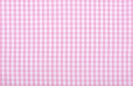 Light pink checkered fabric closeup , tablecloth texture photo