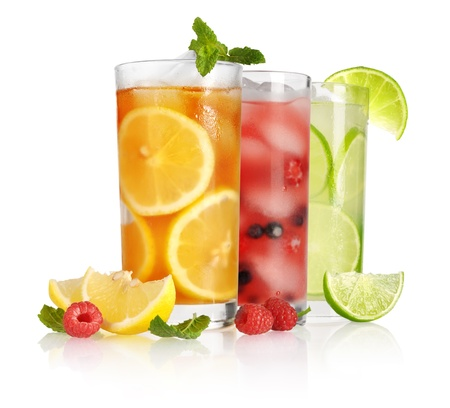 frozen fruit: glass of ice tea with lemon and mint on white background