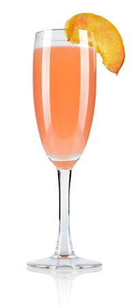 Bellini cocktail with peach isolated on white background photo