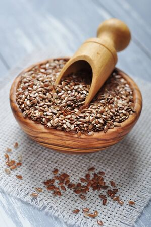 flaxseed: Flax seeds in wooden bowl on wooden background