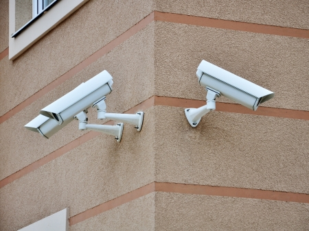 electronic survey: CCTV cameras on the cone of the morden building Stock Photo