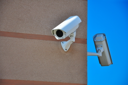 building with security cameras watching around photo