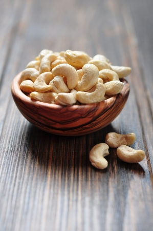 macrobiotic: Roasted cashews on natural wooden table background