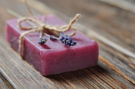 lavander: Lavander handmade soap with lavander flower over wooden background Stock Photo