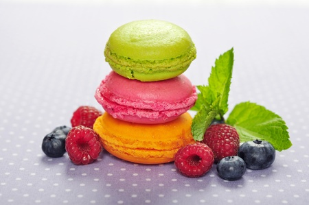 Colorful macaroons with fresh berries and mint photo