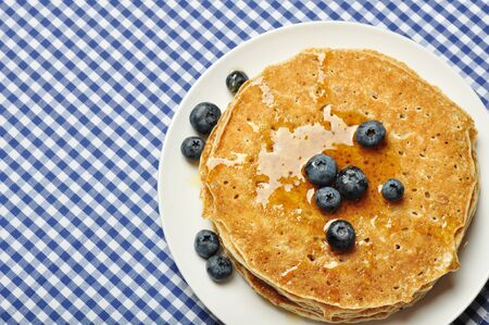 flapjacks: Delicious pancakes with fresh blueberries and maple syrup