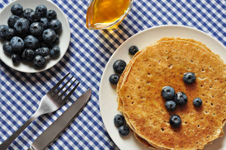 Delicious pancakes with fresh blueberries and maple syrup Stock Photo - 21356563