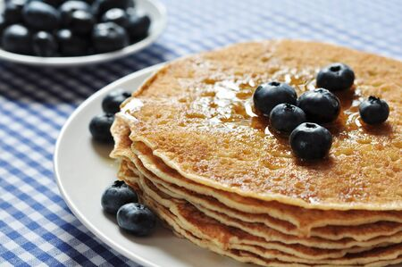 flapjacks: Delicious pancakes close up, with fresh blueberries and maple syrup Stock Photo