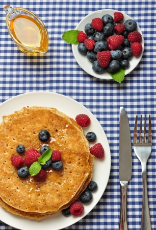 flapjacks: Delicious pancakes with fresh blueberries, raspberry and maple syrup pancakes with fresh berries