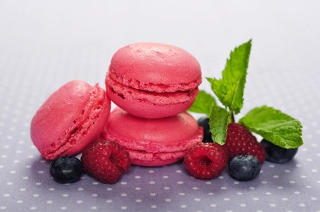Pink macaroons with fresh berries and mint photo