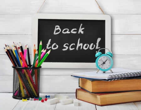 Back to school concept on wooden background photo
