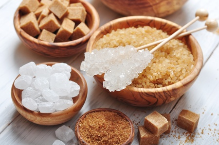 solid food: brown and white sugar in wooden bowls closeup Stock Photo
