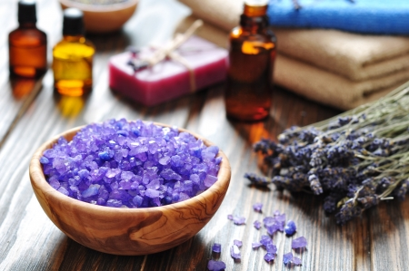 Sea salt in wooden bowl and lavender. Spa concept photo