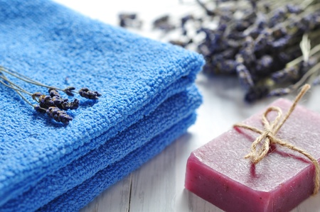 Blue towels and lavender flowers closeup. Spa concept photo