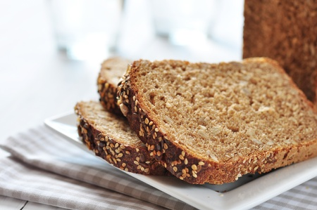 Sliced bread with sunflower seeds and sesame on a plate Stock Photo - 21757294