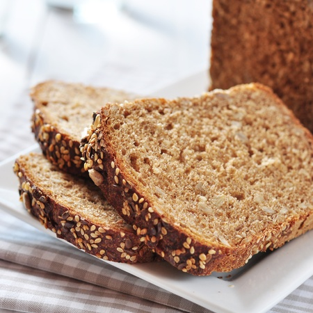 Sliced bread with sunflower seeds and sesame on a plate Stock Photo - 21757295