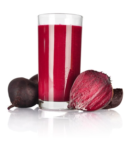 beet juice: A glass of fresh beet vegetable juice isolated on white background