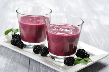 Blackberry smoothie with fresh blackberries on wooden background photo