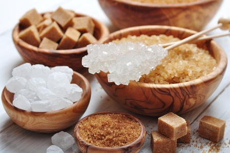 sugar cube: brown and white sugar in wooden bowls closeup Stock Photo