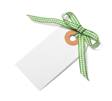 etiquette: White tag with green ribbon bow isolated on white Stock Photo