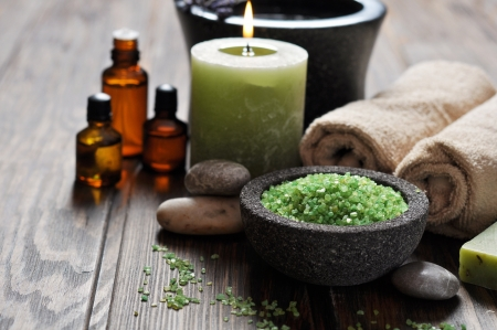 Spa concept. Sea salt in stone bowl with candle and herbal soap Stock Photo