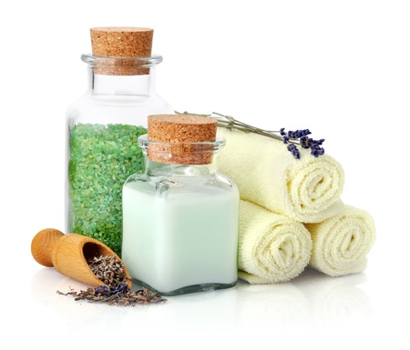 Spa composition with towels, lavender and sea salt isolated on white background photo