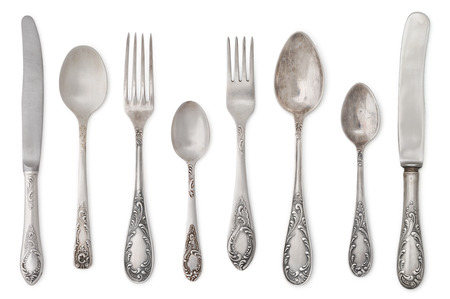 vintage dishware: vintage old cutlery isolated on white background Stock Photo