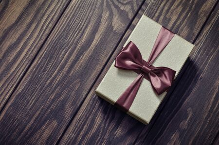 elegant gift box on a wooden background photo