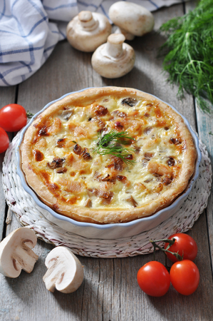 Traditional french quiche pie with chicken and mushroom  on a plate photo