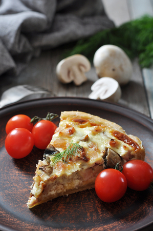champignon: Traditional french quiche pie with chicken and mushroom  on a plate
