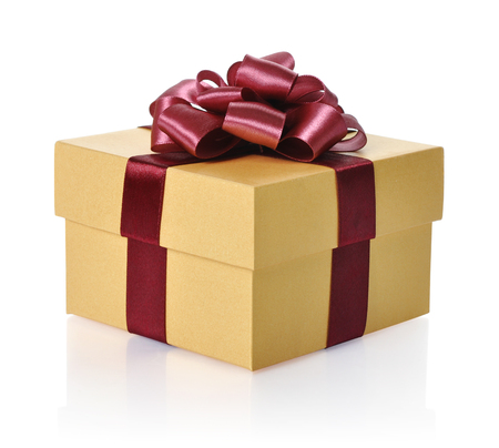 Golden gift box with red ribbon over white background.  photo