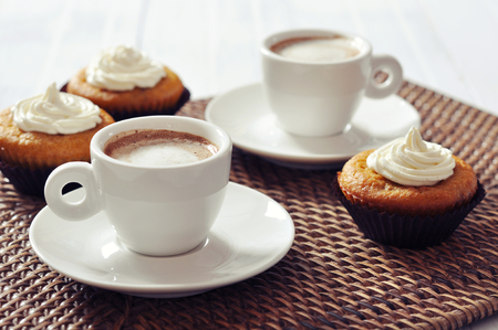 rattan: Cup of coffee with muffins on rattan placemat