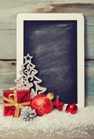 slate board: Slate board with Christmas decoration on wooden background Stock Photo