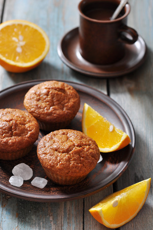 carrot cake: Carrot muffins with fresh oranges fruit on wooden background