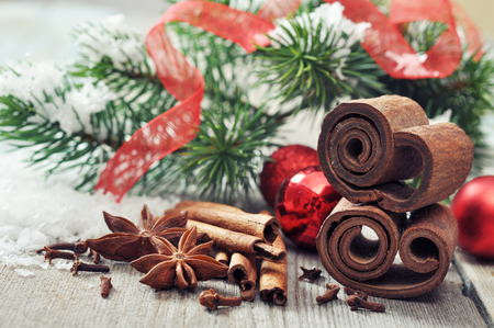 Christmas decorations  with  spices on wooden background photo