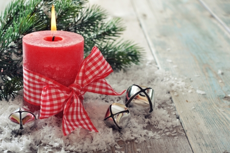 Red candle with christmas decor on wooden background photo