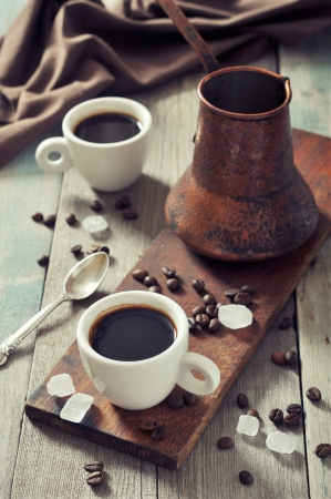 cezve: Coffee in cups with copper cezve on vintage wooden background Stock Photo