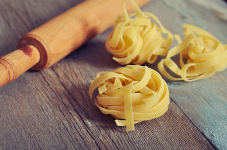 rollingpin: Pasta and rolling-pin on wooden background closeup Stock Photo