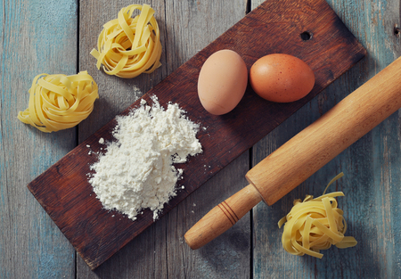 rollingpin: Flour, pasta and rolling-pin on wooden background