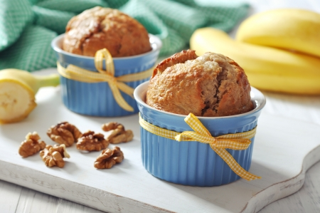 brown banana: Banana muffins in ceramic baking mold with yellow ribbon over wooden background