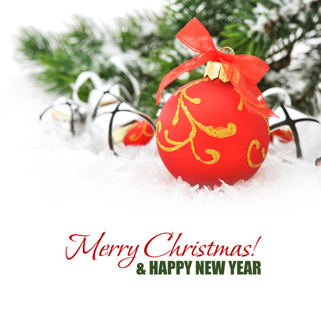 Red christmas ball and fir branches with decorations on snow Stock Photo - 23378292